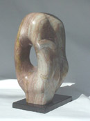 "Kanryuu Sculpture by Carl Wright.  Translation: River Flows Through.  Green & Brown Alabaster on Black Granite Base.  Sculpture: 15""w x 9""d x 20""t.  Base: 8"" x 13"".  $3,000.   Represented by: The Robert Roman Gallery, Scottsdale, AZ. 800-423-3818.  www.RobertRomanGallery.com"